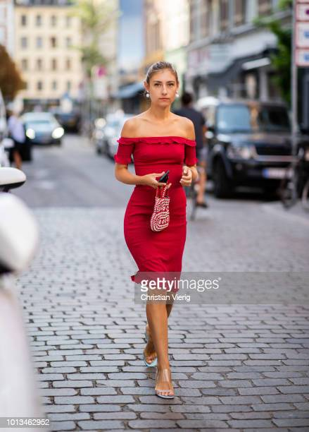 Jenny Walton wearing red off shoulder dress seen outside Rodebjer during the Copenhagen Fashion Week Spring/Summer 2019 on August 8 2018 in...