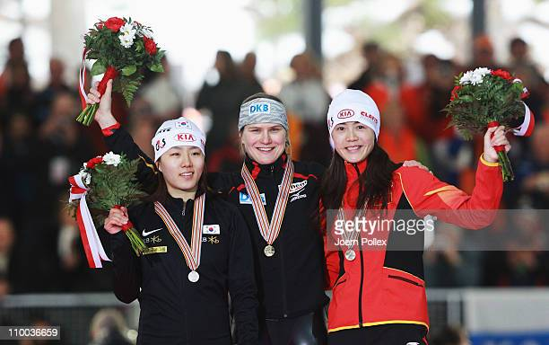 Jenny Wolf of Germany for first place SangHwa Lee of Korea for second place and Beixing Wang of China for third place take place on the podium after...