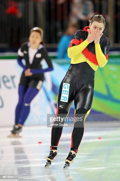 Jenny Wolf of Germany reacts after finishing second to Lee SangHwa of South Korea during the women's speed skating 500 m on day five of the Vancouver...