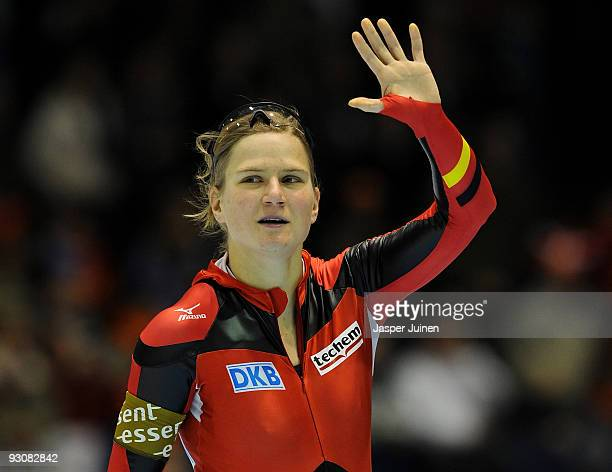 Jenny Wolf of Germany waves to the fans after competing in the 500m race during the Essent ISU speed skating World Cup at the Thialf Stadium on...