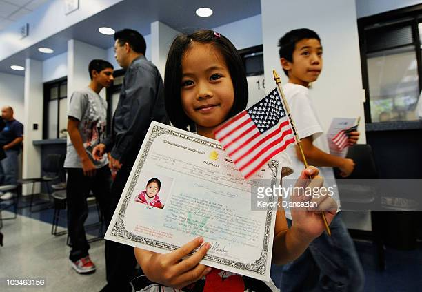 Jenny Ye from China shows her US citizenship certifacte after a citizenship ceremony August 19 2010 in Los Angeles California During the ceremony 143...