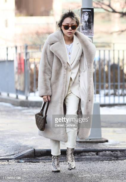 Jenny Zheng is seen wearing a cream fur coat and suit outside the Staud show during New York Fashion Week Fall/Winter 2019 on February 13 2019 in New...