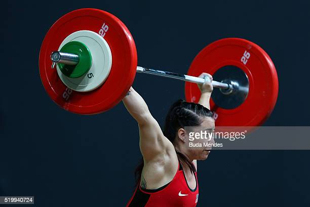 Jennyfer Kang Roberts of the United States competes in the women's 63kg weightlifting competition as a test event for 2016 Rio Olympics at the...