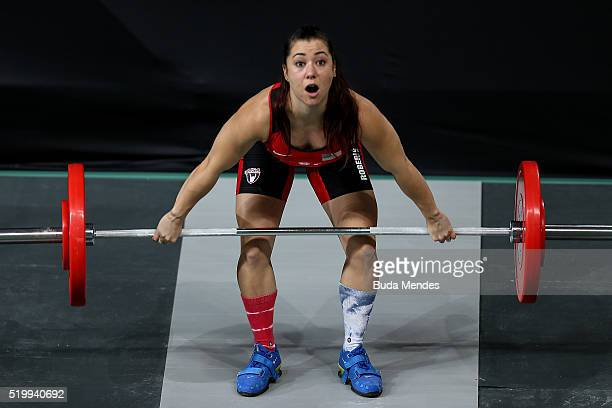 Jennyfer Kang Roberts of the United States pratices during warm up in the women's 63kg weightlifting competition as a test event for 2016 Rio...