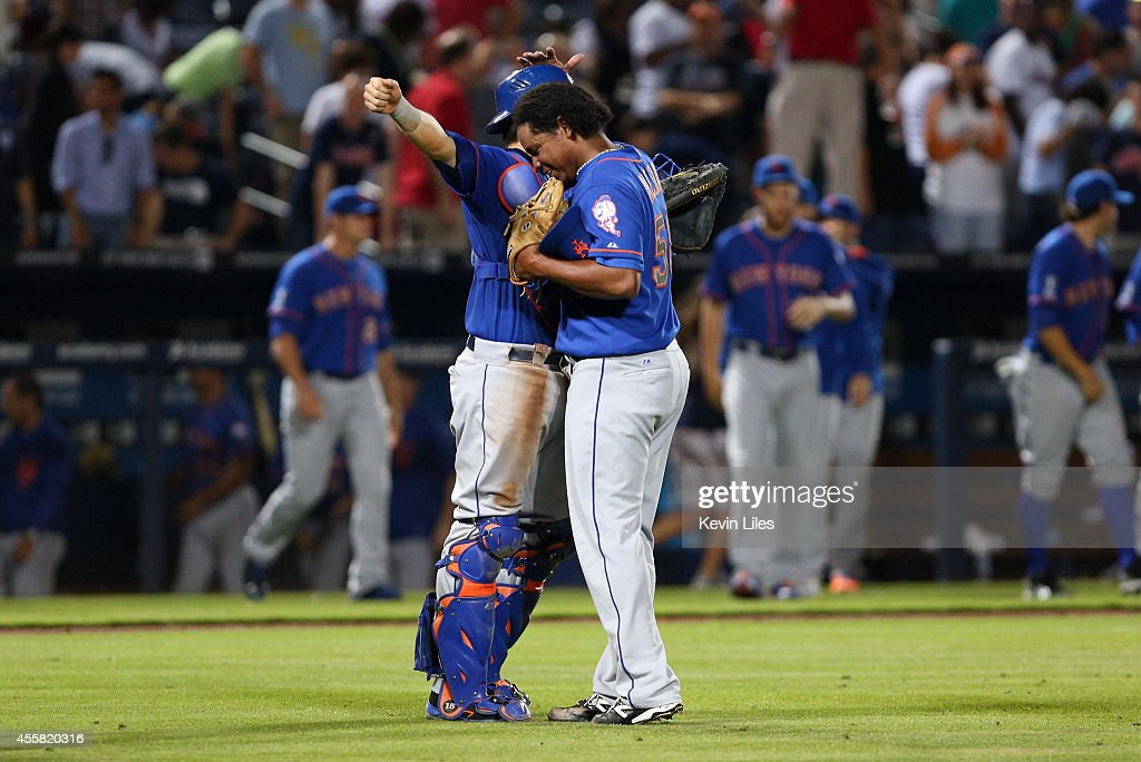 Jenrry Mejia #58 of the New York Mets celebrates with Travis d'Arnaud #15 (left) after defeating the Atlanta Braves 4-2 at Turner Field on September 20, 2014 in Atlanta, Georgia.