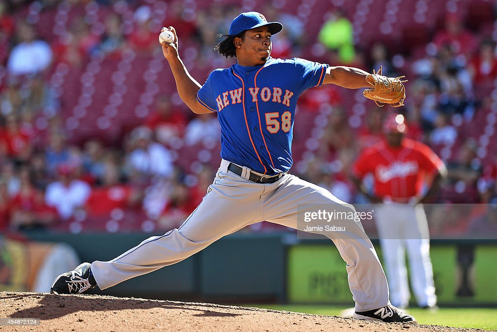 Jenrry Mejia #58 of the New York Mets pitches in the ninth inning against the Cincinnati Reds at Great American Ball Park on September 7, 2014 in Cincinnati, Ohio. New York defeated Cincinnati 4-3.