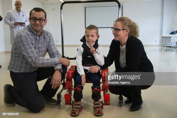 Jens a 5 yearold boy diagnosed with spinal muscular atrophy gestures as he walks with a new Marsi Bionics exoskeleton that designed for disabled...
