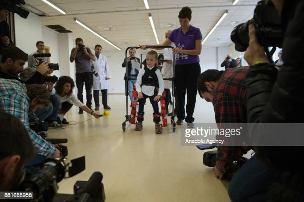Jens a 5 yearold boy diagnosed with spinal muscular atrophy walks with a new Marsi Bionics exoskeleton that designed for disabled children at the...