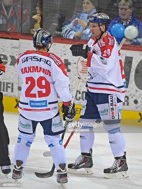 Jens Baxmann and Andre Rankel of the Eisbaeren Berlin celebrate after scoring the 0:2 during the game between Schwenninger Wild Wings and Eisbaeren...