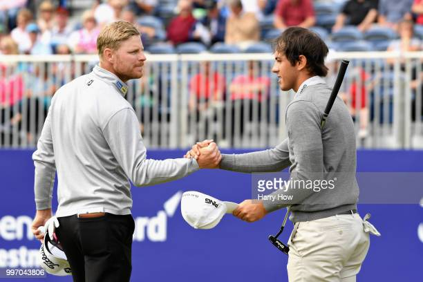 Jens Dantorp of Sweden and Scott Fernandez of Spain shake hands on hole eighteen during day one of the Aberdeen Standard Investments Scottish Open at...