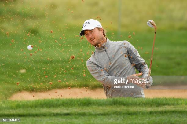 Jens Fahrbring of Sweden plays his second shot from a bunker on the 7th hole during the final round on day four of the DD REAL Czech Masters at...