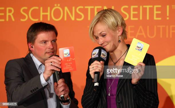 Jens Grittner talks to referee Bibiana Steinhaus during the FIFA Women's World Cup 2011 Countdown event at the Volkswagen Arena on May 5 2010 in...