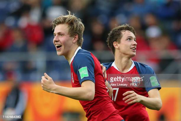 Jens Hauge of Norway celebrates with teammate Hakon Evjen after scoring his team's sixth goal during the 2019 FIFA U-20 World Cup group C match...