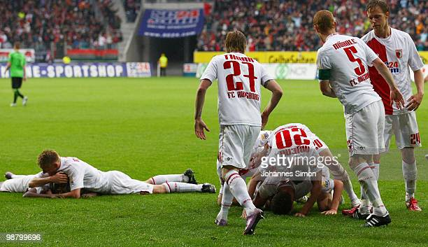 Jens Hegeler of Augsburg celebrates with his team mates after scoring 1-0 during the Second Bundesliga match between FC Augsburg and TSV 1860...