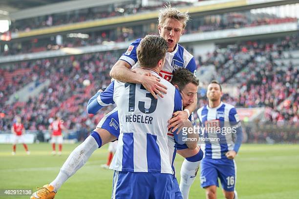 Jens Hegeler of Berlin celebrates his team's first goal with his team mate Per Cijan Skjelbred during the Bundesliga match between 1 FSV Mainz 05 and...