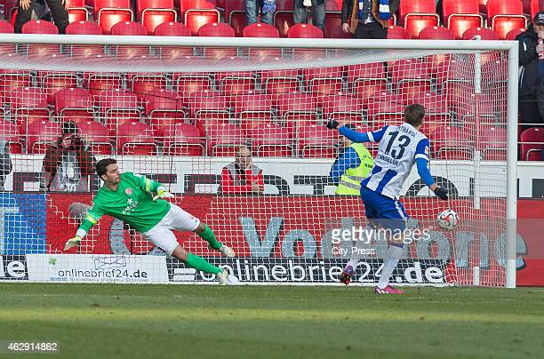 Jens Hegeler of Hertha BSC scores the 0:1 against Stefanos Kapino of FSV Mainz 05 during the game between FSV Mainz and Hertha BSC on february 7,...