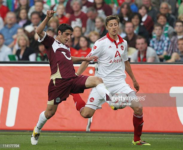 Jens Hegeler of Nuernberg battles for the ball with Lars Stindl of Hannover during the Bundesliga match between Hannover 96 and 1 FC Nuernberg at AWD...