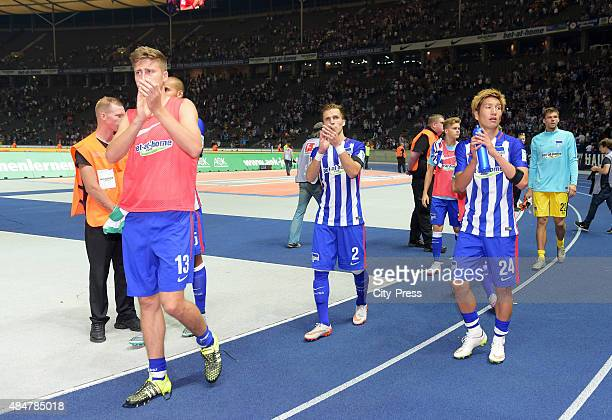Jens Hegeler Peter Pekarik and Genki Haraguchi of Hertha BSC during the game between Hertha BSC and Werder Bremen on August 21 2015 in Berlin Germany