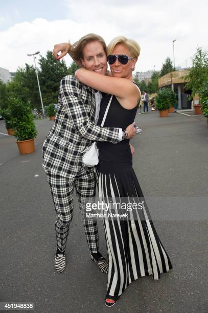 Jens Hilbert and Claudia Effenberg attends the Marcel Ostertag show during the MercedesBenz Fashion Week Spring/Summer 2015 at Erika Hess Eisstadion...