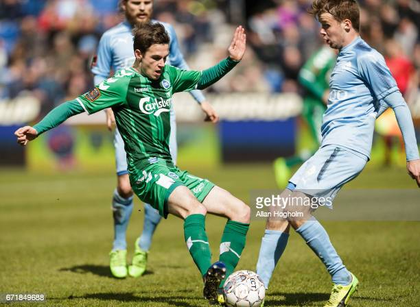 Jens Jakob Thomasen of OB and Nicolai Poulsen of Randers FC compete for the ball during the Danish Alka Superliga match between Randers FC and OB...