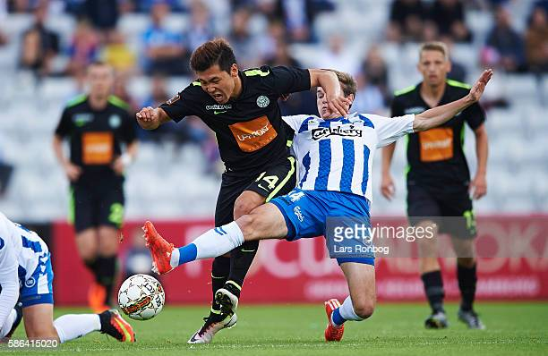 Jens Jakob Thomasen of OB Odense and JungBin Park of Viborg FF compete for the ball during the Danish Alka Superliga match between OB Odense and...