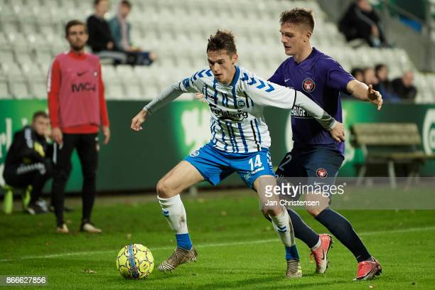 Jens Jakob Thomasen of OB Odense and Mikkel Duelund of FC Midtjylland compete for the ball during the Danish Cup DBU Pokalen match between OB Odense...