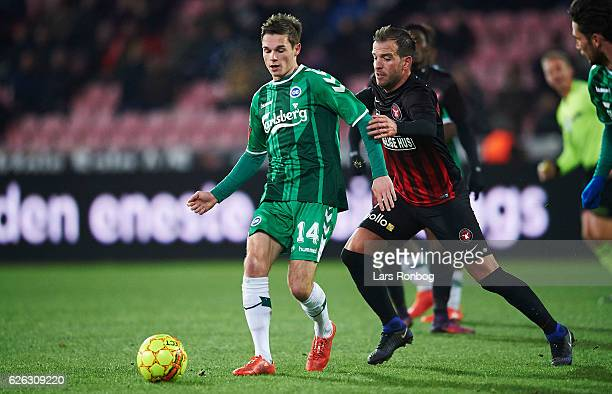 Jens Jakob Thomasen of OB Odense and Rafael van der Vaart of FC Midtjylland compete for the ball during the Danish Alka Superliga match between FC...