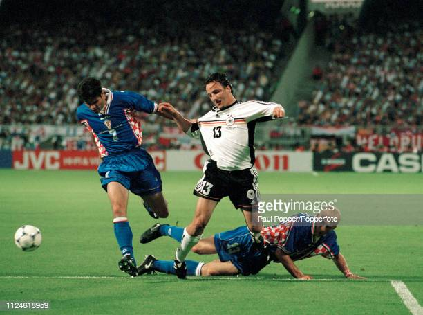 Jens Jeremies of Germany is challenged by Aljosa Asanovic and Mario Stanic of Croatia during a 1998 FIFA World Cup Quarter Final at the Stade de...