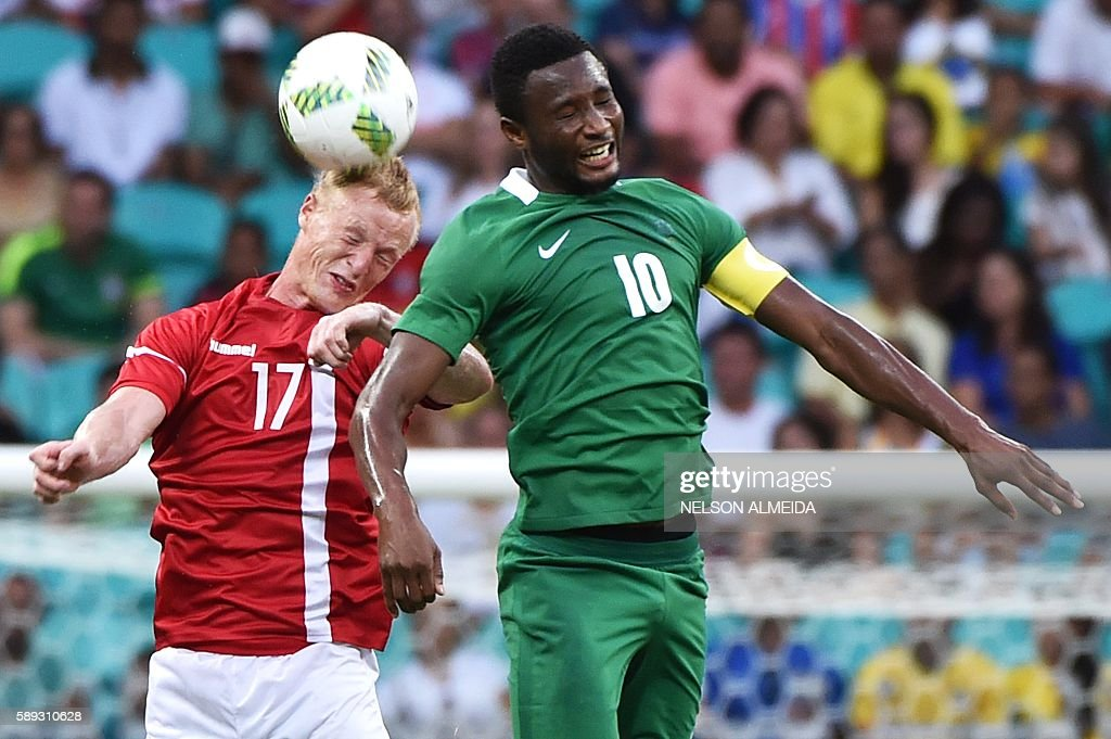 TOPSHOT - Jens Jonsson (L) of Denmark vies for the ball with John Obi Mikel (R) of Nigeria during the Rio 2016 Olympic Games mens quarter-final football match Nigeria vs Denmark, at the Arena Fonte Nova Stadium in Salvador, Brazil on August 13, 2016. / AFP / NELSON