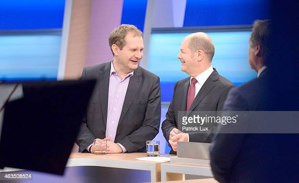 Jens Kerstan of of the German Greens Party stand together with Hamburgs First Mayor and potential coalition partner Olaf Scholz of SPD in a TV studio...