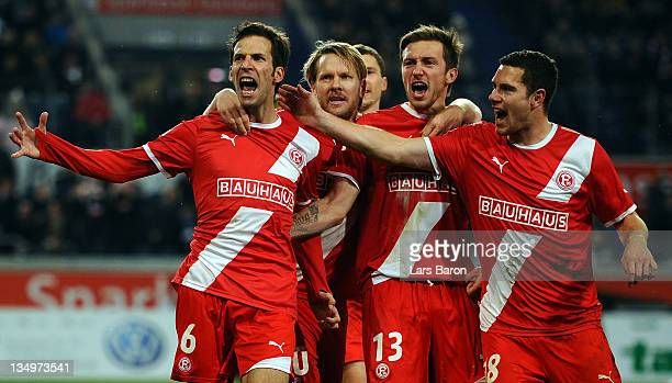 Jens Langeneke of Duesseldorf celebrates with team mates after scoring his teams first goal during the Second Bundesliga match between MSV Duisburg...