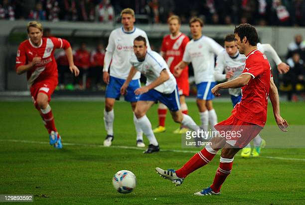 JEns Langeneke of Duesseldorf scores his teams first goal during the Second Bundesliga match between Fortuna Duesseldorf and Hansa Rostock at Esprit...