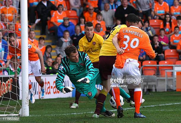 Jens Lehman of Arsenal makes a save to stop DJ Campbell of Blackpool from scoring during the Barclays Premier League match between Blackpool and...