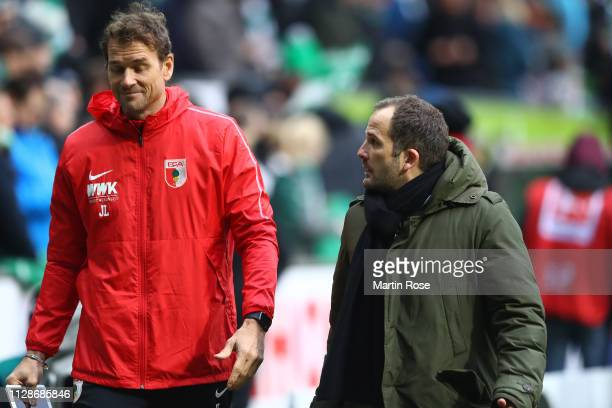 Jens Lehmann , assistent coach of Augsburg reacts with Manuel Baum, head coach of Augsburg during the Bundesliga match between SV Werder Bremen and...