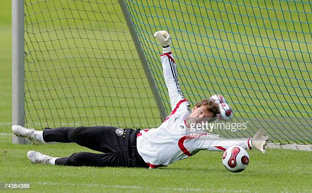 Jens Lehmann goalkeeper of Germany saves the ball during the German National Team training session at the AOL Arena on June 3 2007 in Hamburg Germany