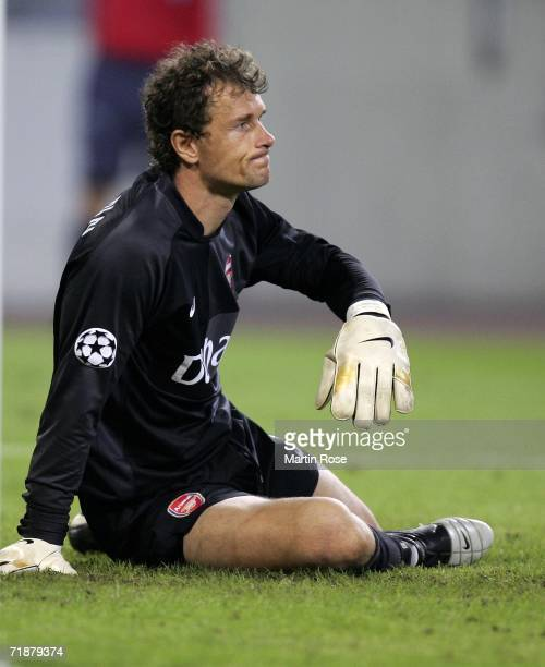 Jens Lehmann goalkkeper of Arsenal sits on the pitch during the UEFA Champions League Group G match between Hamburger SV and Arsenal at the AOL Arena...