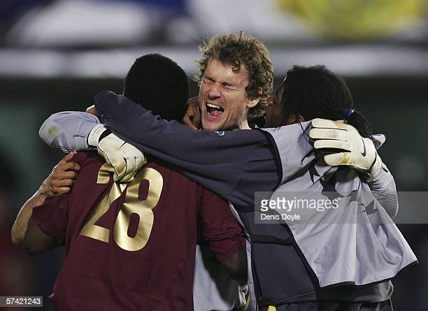 Jens Lehmann of Arsenal celebrates with Kolo Toure at the end of the UEFA Champions League semi-final, second leg match between Arsenal and...