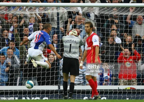 Jens Lehmann of Arsenal concedes a goal after dropping the ball as David Bentley celebrates during the Barclays Premiership league match between...