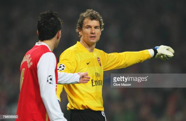 Jens Lehmann of Arsenal gives instructions to Cesc Fabregas of Arsenal during the UEFA Champions League first knockout round first leg match between...