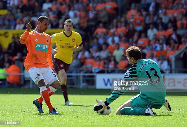 Jens Lehmann of Arsenal saves the shot of DJ Campbell of Blackpool during the Barclays Premier League match between Blackpool and Arsenal at...