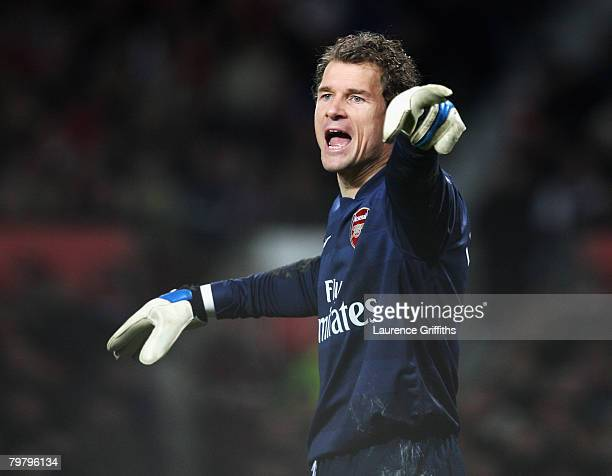 Jens Lehmann of Arsenal shouts to his team mates during the FA Cup sponsored by EON 5th Round match between Manchester United and Arsenal at Old...