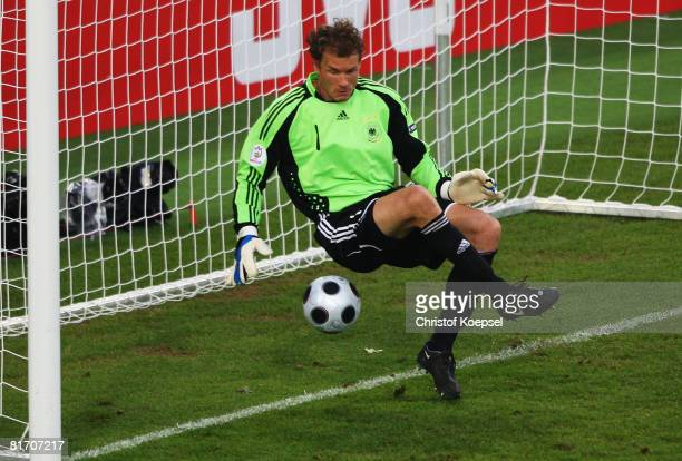 Jens Lehmann of Germany cannot stop the ball from crossing the line to prevent Turkey's opening goal during the UEFA EURO 2008 Semi Final match...