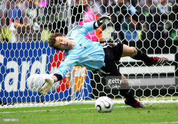 Jens Lehmann of Germany dives for a shot in the penalty kick shootout during the quarterfinal match against Argentina at the Olympiastadion in Berlin...