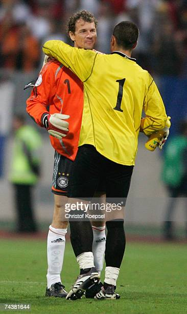 Jens Lehmann of Germany embraces Aldo Junior Simoncini of San Marino after winning 60 the UEFA EURO 2008 qualifier between Germany and San Marino at...