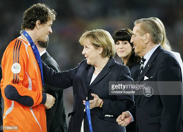Jens Lehmann of Germany is presented with his third place medal by German Chancellor Angela Merkel after the FIFA World Cup Germany 2006 Third Place...
