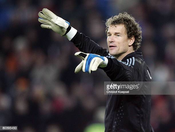 Jens Lehmann of Germany issues instructions during the international friendly match between Switzerland and Germany at the St JakobPark on March 26...