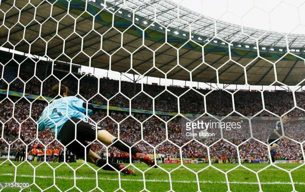Jens Lehmann of Germany saves a penalty taken by Esteban Cambiasso of Argentina in a penalty shootout during the FIFA World Cup Germany 2006...