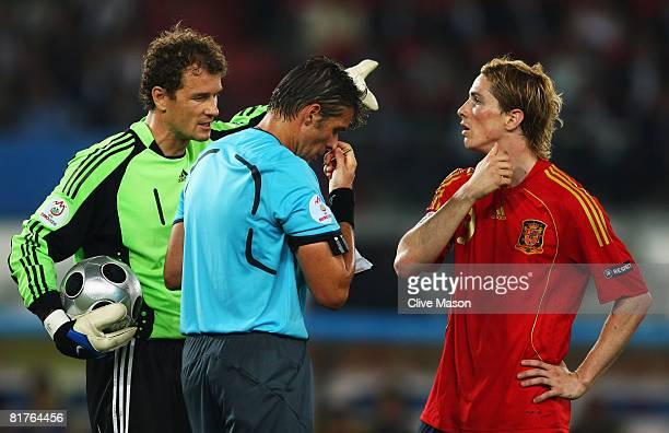 Jens Lehmann of Germany talks to referee Roberto Rosetti of Italy as Fernando Torres of Spain looks on during the UEFA EURO 2008 Final match between...