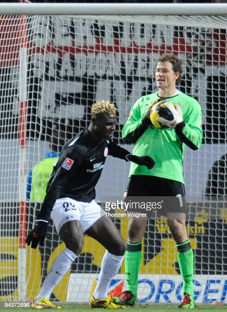 Jens Lehmann of Stuttgart fouls Aristide Bance during the Bundesliga match between FSV Mainz 05 and VFB Stuttgart at Bruchweg Stadium on December 13...