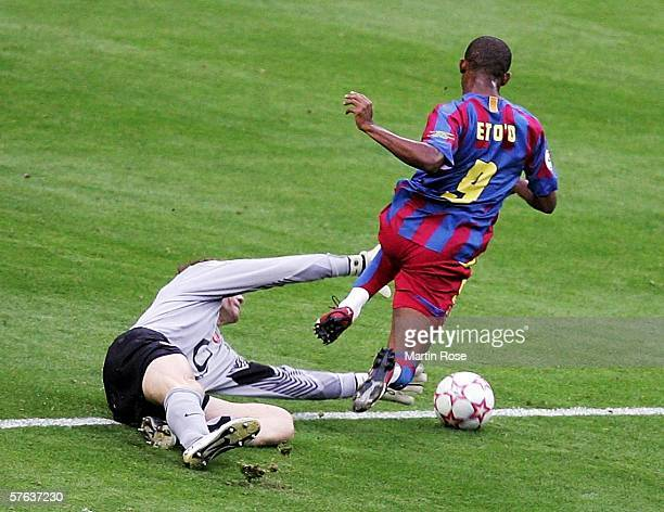 Jens Lehmann the Arsenal goalkeeper brings down Samuel Eto'o of Barcelona and is sent off during the UEFA Champions League Final between Arsenal and...